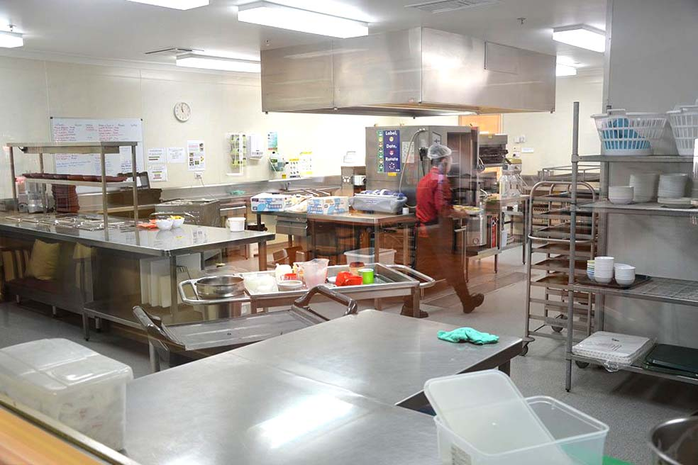 Kitchen staff working hard to bring you tasty and nutritious meals.